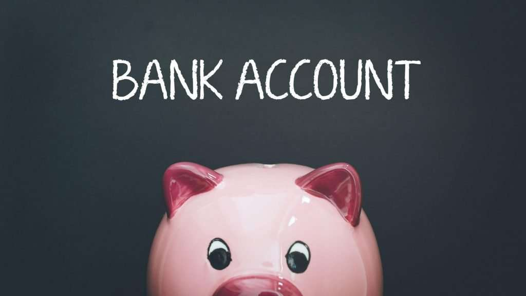 Chalk background with pink pig, business bank account